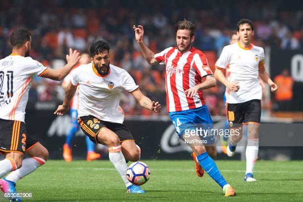 Ezequiel Garay of Valencia CF and Duje Cop of Real Sporting de Gijon during their La Liga match between Valencia CF and Real Sporting de Gijon at the...