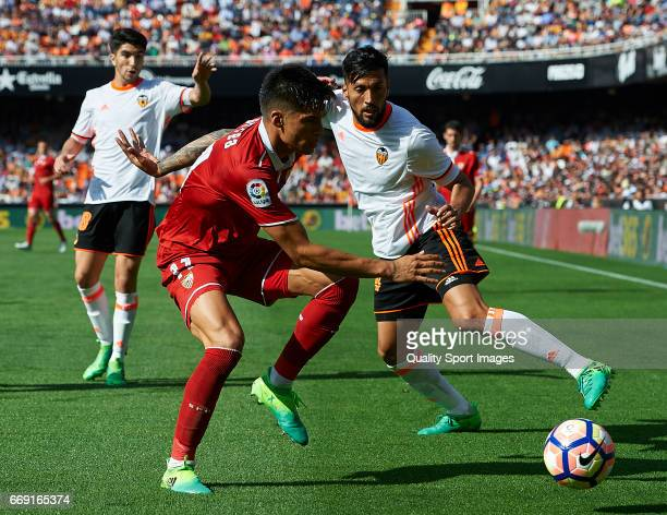 Ezequiel Garay of Valencia competes for the ball with Joaquin Correa of Sevilla during the La Liga match between Valencia CF and Sevilla FC at...