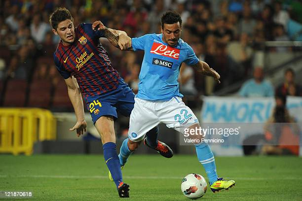 Ezequiel Ivan Lavezzi of SSC Napoli is challenged by Andreu Fontas of FC Barcelona during the Joan Gamper Trophy match between FC Barcelona and SSC...