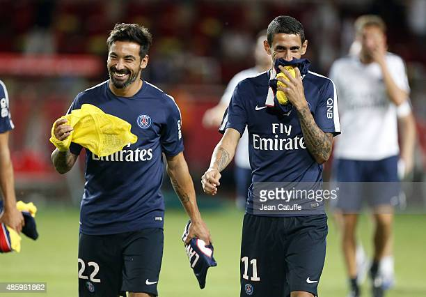 Ezequiel Lavezzi and Angel Di Maria of PSG joke during the French Ligue 1 match between AS Monaco and Paris SaintGermain at Stade Louis II on August...