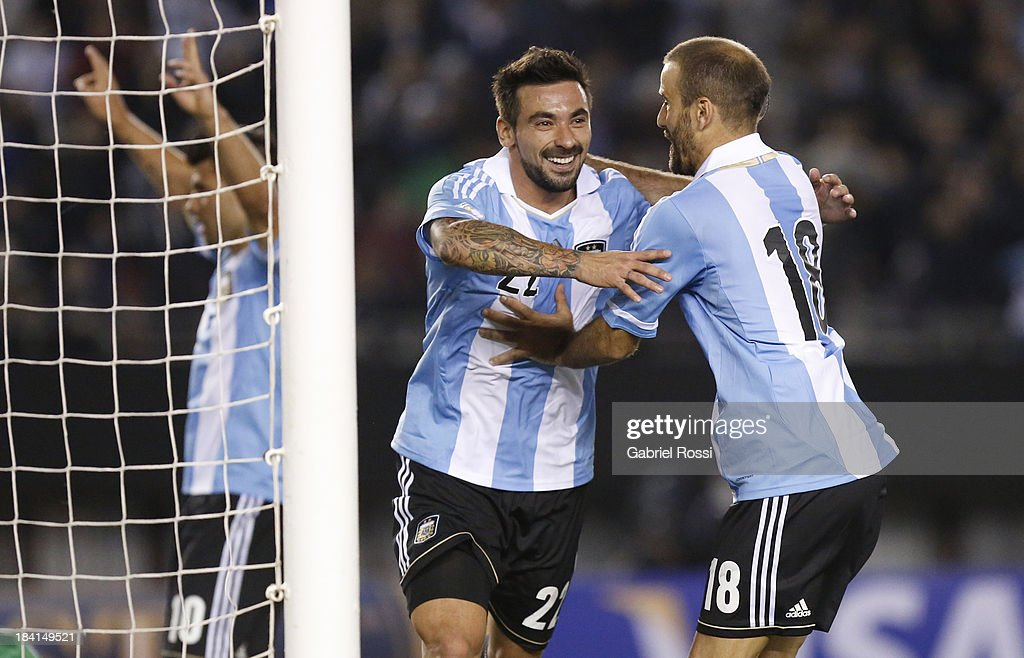 Ezequiel Lavezzi and Rodrigo Palacio celebrate a goal during a match between Argentina and Peru as part of the 17th round of the South American...