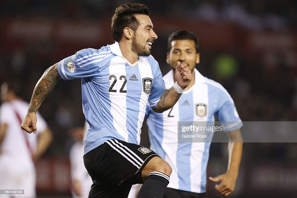 Ezequiel Lavezzi celebrates the first goal during a match between Argentina and Peru as part of the 17th round of the South American Qualifiers at...