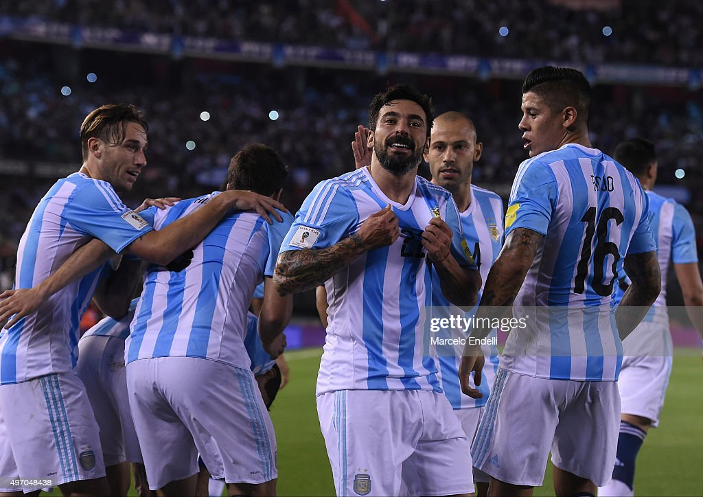 Ezequiel Lavezzi of Argentina celebrates with teammates after scoring the opening goal during a match between Argentina and Brazil as part of FIFA...