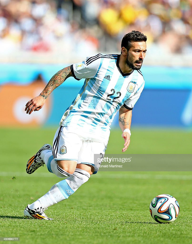 <a gi-track='captionPersonalityLinkClicked' href=/galleries/search?phrase=Ezequiel+Lavezzi&family=editorial&specificpeople=5451126 ng-click='$event.stopPropagation()'>Ezequiel Lavezzi</a> of Argentina controls the ball during the 2014 FIFA World Cup Brazil Group F match between Argentina and Iran at Estadio Mineirao on June 21, 2014 in Belo Horizonte, Brazil.