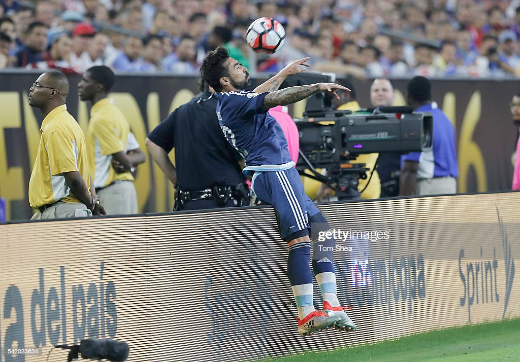 <a gi-track='captionPersonalityLinkClicked' href=/galleries/search?phrase=Ezequiel+Lavezzi&family=editorial&specificpeople=5451126 ng-click='$event.stopPropagation()'>Ezequiel Lavezzi</a> of Argentina flips over the boards while controlling the ball during the Semifinal match between United States and Argentina at NRG Stadium as part of Copa America Centenario US 2016 on June 21, 2016 in Houston, Texas, US.