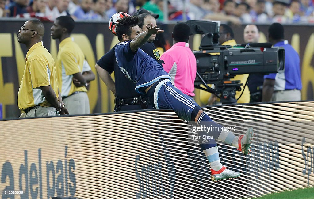 Ezequiel Lavezzi of Argentina flips over the boards while controlling the ball during the Semifinal match between United States and Argentina at NRG...