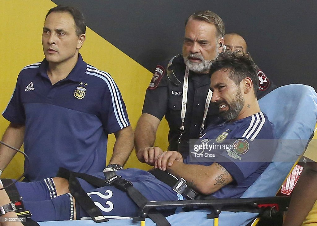 <a gi-track='captionPersonalityLinkClicked' href=/galleries/search?phrase=Ezequiel+Lavezzi&family=editorial&specificpeople=5451126 ng-click='$event.stopPropagation()'>Ezequiel Lavezzi</a> of Argentina is carted off the pitch after he flipped over the boards during the Semifinal match between United States and Argentina at NRG Stadium as part of Copa America Centenario US 2016 on June 21, 2016 in Houston, Texas, US.