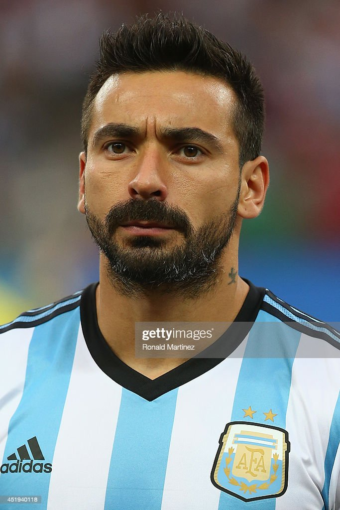 <a gi-track='captionPersonalityLinkClicked' href=/galleries/search?phrase=Ezequiel+Lavezzi&family=editorial&specificpeople=5451126 ng-click='$event.stopPropagation()'>Ezequiel Lavezzi</a> of Argentina looks on during the National Anthem prior to the 2014 FIFA World Cup Brazil Semi Final match between the Netherlands and Argentina at Arena de Sao Paulo on July 9, 2014 in Sao Paulo, Brazil.