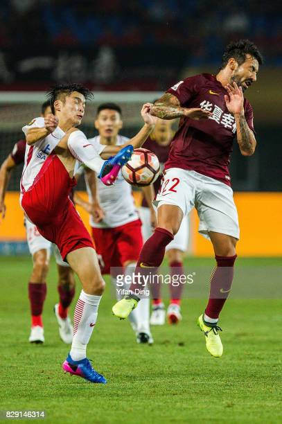 Ezequiel Lavezzi of Hebei China Fortune and Wei Zhen of Shanghai SIPG fight for the ball during the China Super League match between Hebei China...