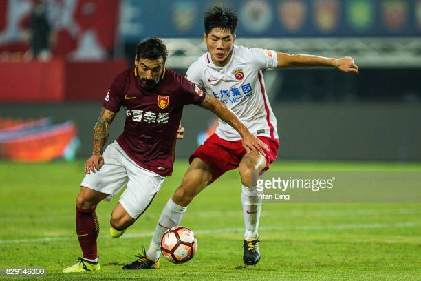 Ezequiel Lavezzi of Hebei China Fortune dribbles past Wei Zhen of Shanghai SIPG during the China Super League match between Hebei China Fortune and...