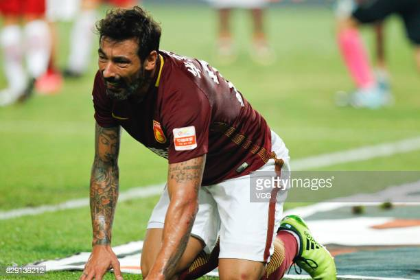 Ezequiel Lavezzi of Hebei China Fortune knees down during the 21st round match of 2017 China Super League between Hebei China Fortune FC and Shanghai...