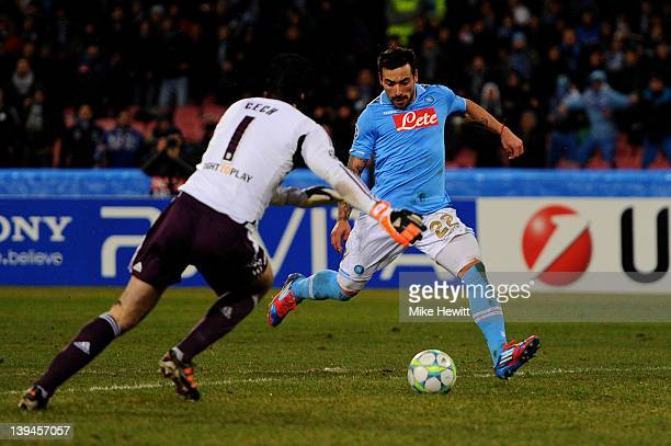 Ezequiel Lavezzi of Napoli shoots past Petr Cech of Chelsea to score his team's third goal during the UEFA Champions League round of 16 first leg...