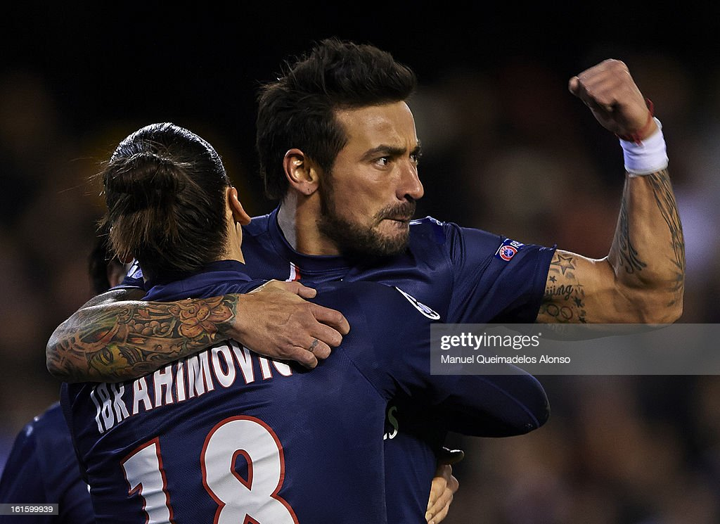 Ezequiel Lavezzi of Paris Saint-Germain celebrates scoring with his teammate <a gi-track='captionPersonalityLinkClicked' href=/galleries/search?phrase=Zlatan+Ibrahimovic&family=editorial&specificpeople=206139 ng-click='$event.stopPropagation()'>Zlatan Ibrahimovic</a> during the UEFA Champions League Round of 16 match between Valencia CF and Paris St Germain at Estadi de Mestalla on February 12, 2013 in Valencia, Spain.