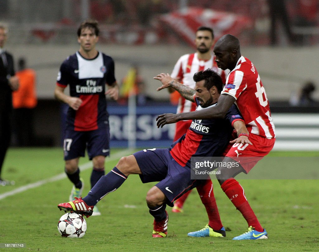 <a gi-track='captionPersonalityLinkClicked' href=/galleries/search?phrase=Ezequiel+Lavezzi&family=editorial&specificpeople=5451126 ng-click='$event.stopPropagation()'>Ezequiel Lavezzi</a> (L) of Paris Saint-Germain FC is challenged by <a gi-track='captionPersonalityLinkClicked' href=/galleries/search?phrase=Sambou+Yatabare&family=editorial&specificpeople=5747366 ng-click='$event.stopPropagation()'>Sambou Yatabare</a> of Olympiacos FC during the UEFA Champions League group stage match between Olympiacos FC and Paris Saint-Germain FC held on September 17, 2013 at the Georgios Karaiskakis Stadium in Athens, Greece.