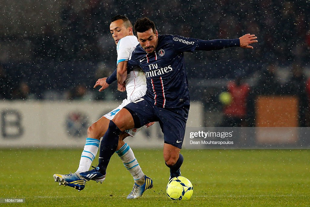 <a gi-track='captionPersonalityLinkClicked' href=/galleries/search?phrase=Ezequiel+Lavezzi&family=editorial&specificpeople=5451126 ng-click='$event.stopPropagation()'>Ezequiel Lavezzi</a> of PSG and <a gi-track='captionPersonalityLinkClicked' href=/galleries/search?phrase=Foued+Kadir&family=editorial&specificpeople=4520875 ng-click='$event.stopPropagation()'>Foued Kadir</a> of Marseille battle for the ball during the Ligue 1 match between Paris Saint-Germain FC and Olympique de Marseille at Parc des Princes on February 24, 2013 in Paris, France.