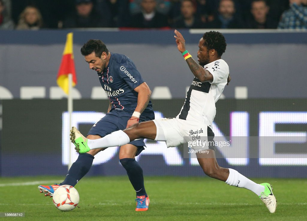 <a gi-track='captionPersonalityLinkClicked' href=/galleries/search?phrase=Ezequiel+Lavezzi&family=editorial&specificpeople=5451126 ng-click='$event.stopPropagation()'>Ezequiel Lavezzi</a> of PSG and <a gi-track='captionPersonalityLinkClicked' href=/galleries/search?phrase=Jean+Makoun&family=editorial&specificpeople=807728 ng-click='$event.stopPropagation()'>Jean Makoun</a> of Rennes in action during the french Ligue 1 match between Paris Saint Germain FC and Stade Rennais FC at the Parc des Princes stadium on November 17, 2012 in Paris, France.