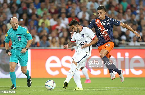 Ezequiel Lavezzi of PSG and Ramy Bensebaini of Montpellier in action during the French Ligue 1 match between Montpellier Herault SC v Paris...