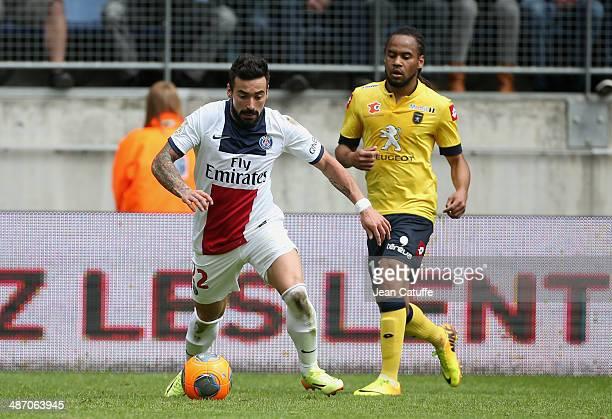 Ezequiel Lavezzi of PSG and Roy Contout of Sochaux in action during the french Ligue 1 match between FC Sochaux Montbeliard and Paris SaintGermain FC...