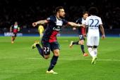 Ezequiel Lavezzi of PSG celebrates after scoring the opening goal during the UEFA Champions League quarter final first leg match between Paris Saint...
