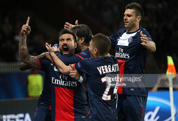 Ezequiel Lavezzi of PSG celebrates his goal with teammate Marco Verratti Thiago Motta of PSG during the UEFA Champions League quarter final match...