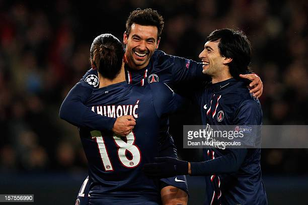 Ezequiel Lavezzi of PSG celebrates scoring his teams second goal of the game with team mates Zlatan Ibrahimovic and Javier Pastore during the Group A...