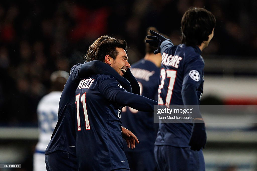 <a gi-track='captionPersonalityLinkClicked' href=/galleries/search?phrase=Ezequiel+Lavezzi&family=editorial&specificpeople=5451126 ng-click='$event.stopPropagation()'>Ezequiel Lavezzi</a> (#11) of PSG celebrates scoring his teams second goal of the game with team mates during the Group A UEFA Champions League match between Paris Saint-Germain FC and FC Porto at Parc des Princes on December 4, 2012 in Paris, France.