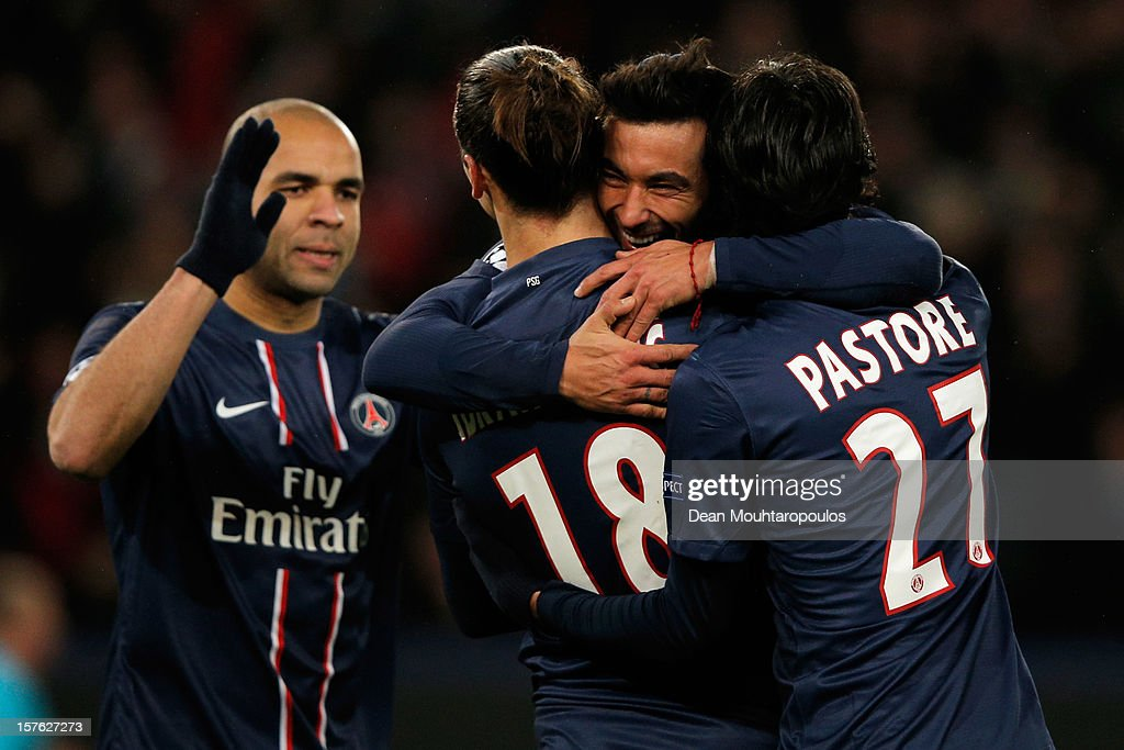 <a gi-track='captionPersonalityLinkClicked' href=/galleries/search?phrase=Ezequiel+Lavezzi&family=editorial&specificpeople=5451126 ng-click='$event.stopPropagation()'>Ezequiel Lavezzi</a> (C) of PSG celebrates scoring his teams second goal of the game with team mates <a gi-track='captionPersonalityLinkClicked' href=/galleries/search?phrase=Zlatan+Ibrahimovic&family=editorial&specificpeople=206139 ng-click='$event.stopPropagation()'>Zlatan Ibrahimovic</a> and <a gi-track='captionPersonalityLinkClicked' href=/galleries/search?phrase=Javier+Pastore&family=editorial&specificpeople=5857872 ng-click='$event.stopPropagation()'>Javier Pastore</a> during the Group A UEFA Champions League match between Paris Saint-Germain FC and FC Porto at Parc des Princes on December 4, 2012 in Paris, France.
