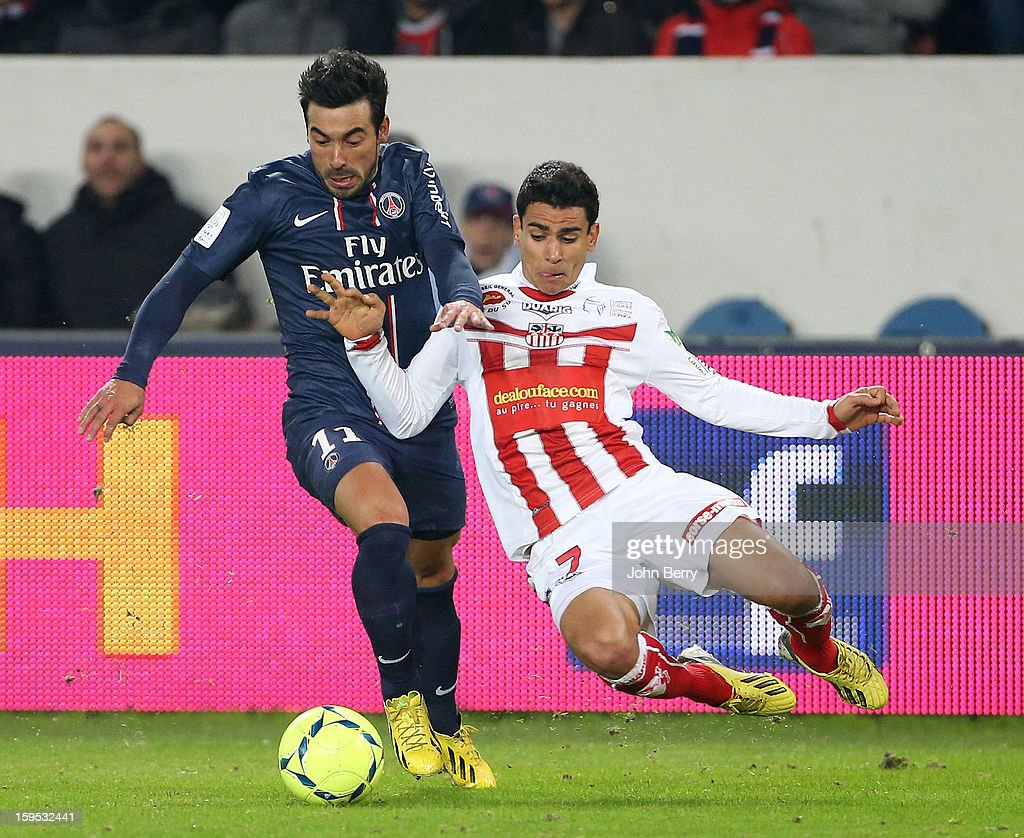 Ezequiel Lavezzi (L) of PSG is challenged by Benjamin Andre of AC Ajaccio during the French Ligue 1 match between Paris Saint Germain FC and AC Ajaccio at the Parc des Princes stadium on January 11, 2013 in Paris, France.