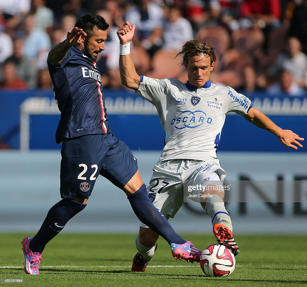 <a gi-track='captionPersonalityLinkClicked' href=/galleries/search?phrase=Ezequiel+Lavezzi&family=editorial&specificpeople=5451126 ng-click='$event.stopPropagation()'>Ezequiel Lavezzi</a> of PSG is tackled by <a gi-track='captionPersonalityLinkClicked' href=/galleries/search?phrase=Guillaume+Gillet&family=editorial&specificpeople=4542498 ng-click='$event.stopPropagation()'>Guillaume Gillet</a> of Bastia during the French Ligue 1 match between Paris Saint Germain FC and SC Bastia at Parc des Princes stadium on August 16, 2014 in Paris, France.