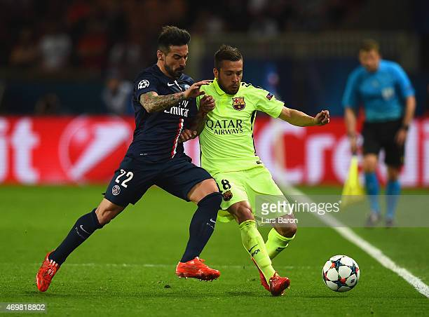 Ezequiel Lavezzi of PSG tackles Jordi Alba of Barcelona during the UEFA Champions League Quarter Final First Leg match between Paris SaintGermain and...