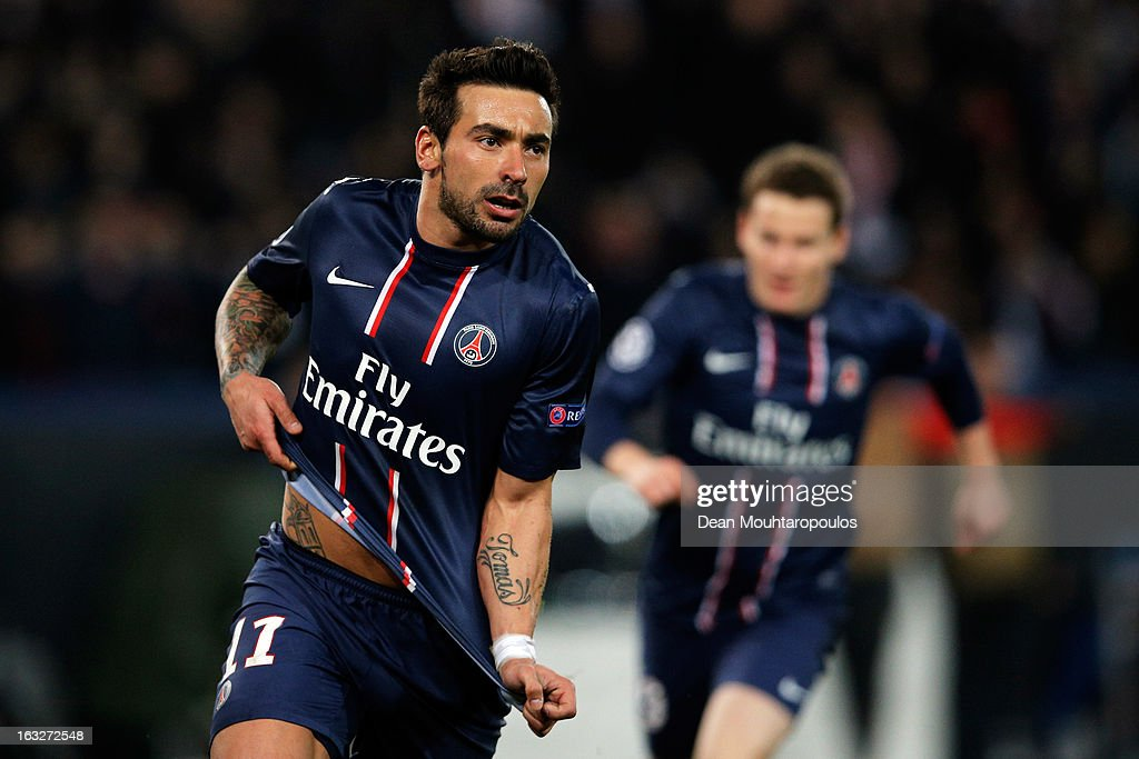 Ezequiel Lavezzi of PSG takes off his shirt and celebrates after he scores his team first goal during the Round of 16 UEFA Champions League match between Paris St Germain and Valencia CF at Parc des Princes on March 6, 2013 in Paris, France.