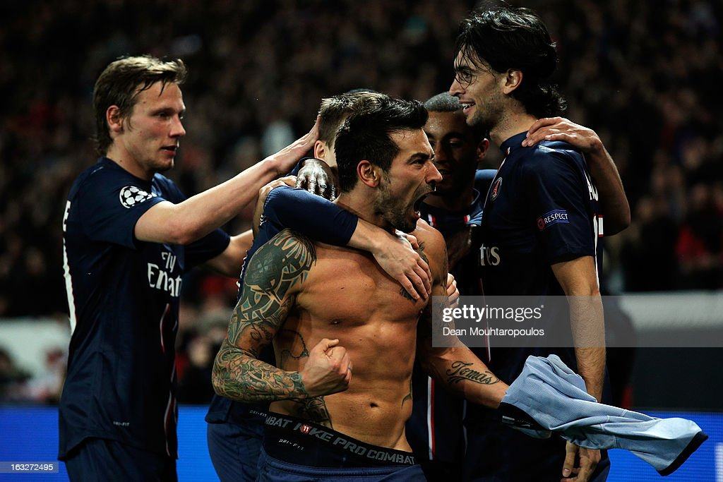 Ezequiel Lavezzi of PSG takes off his shirt and celebrates with team mates after he scores his team first goal during the Round of 16 UEFA Champions...