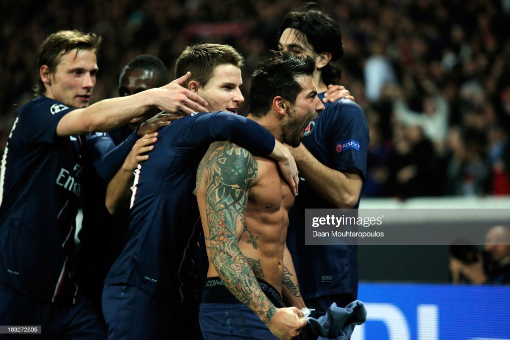 <a gi-track='captionPersonalityLinkClicked' href=/galleries/search?phrase=Ezequiel+Lavezzi&family=editorial&specificpeople=5451126 ng-click='$event.stopPropagation()'>Ezequiel Lavezzi</a> of PSG takes off his shirt and celebrates with team mates after he scores his team first goal during the Round of 16 UEFA Champions League match between Paris St Germain and Valencia CF at Parc des Princes on March 6, 2013 in Paris, France.