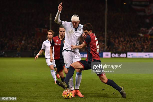 Ezequiel Munoz of Genoa CFC competes with Sergej Milinkovic of SS Lazio during the Serie A match between Genoa CFC and SS Lazio at Stadio Luigi...