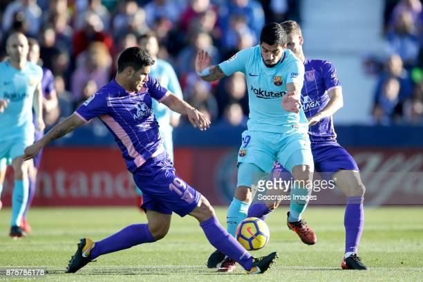 Ezequiel Munoz of Leganes Luis Suarez of FC Barcelona during the Spanish Primera Division match between Leganes v FC Barcelona at the Estadio...