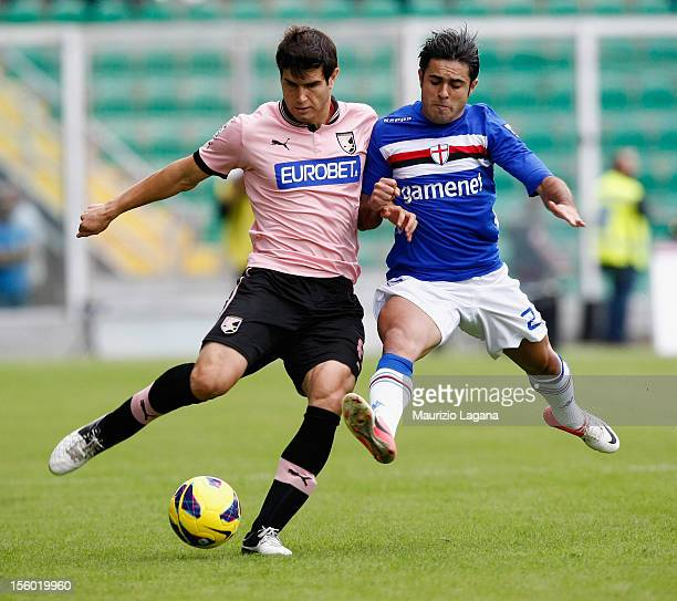 Ezequiel Munoz of Palermo competes for the ball with Martins Eder of Sampdoria during the Serie A match between US Citta di Palermo and UC Sampdoria...