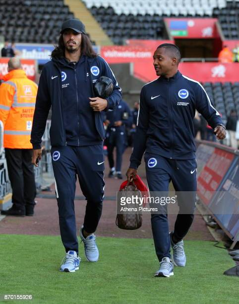 Ezequiel Schelotto and Jose Izquierdo of Brighton arrive prior to the game during the Premier League match between Swansea City and Brighton and Hove...