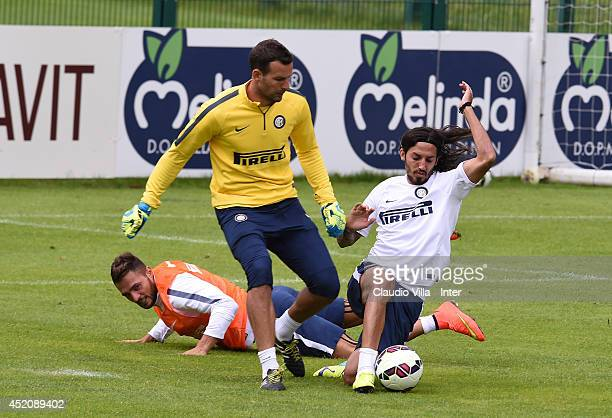 Ezequiel Schelotto and Samir Handanovic compete for the ball during of FC Internazionale Milano training session on July 13 2014 in Pinzolo near...