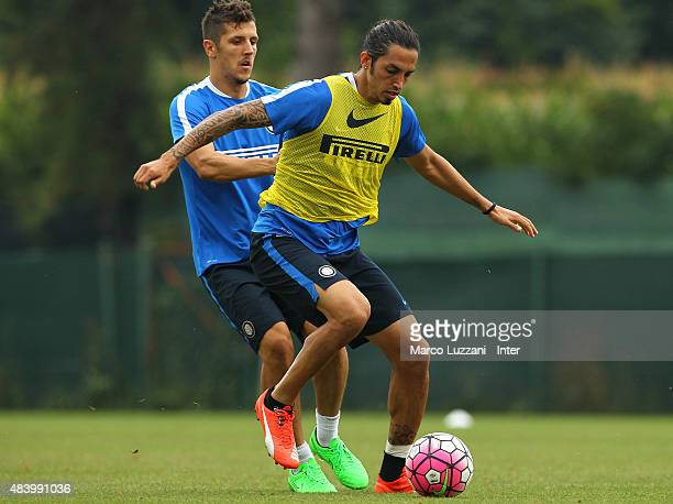 Ezequiel Schelotto competes with Stevan Jovetic during FC Internazionale training session at the club's training ground on August 14 2015 in Appiano...