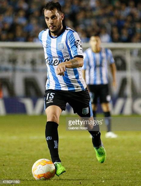 Ezequiel Videla of Racing Club drives the ball during a second leg match between Racing Club and Guarani as part of quarter finals of Copa...