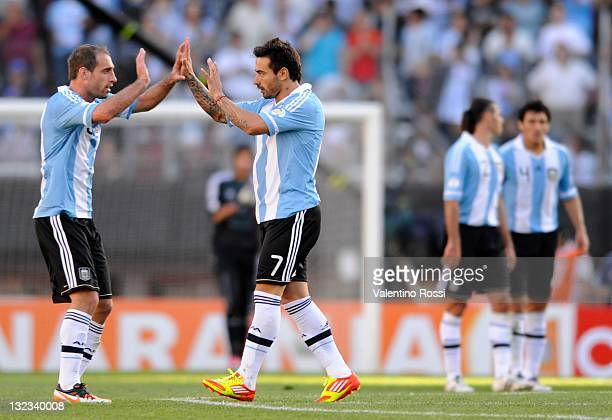 Ezezquiel Lavezzi from Argentina celebrates a goal with the teammate Pablo Zabaleta during a match between Argentina and Bolivia as part of the third...