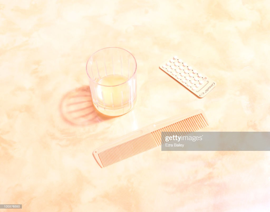 Comb on yellow table : Stock Photo