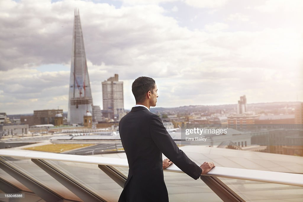Businessman looking out over the city. : Stock Photo