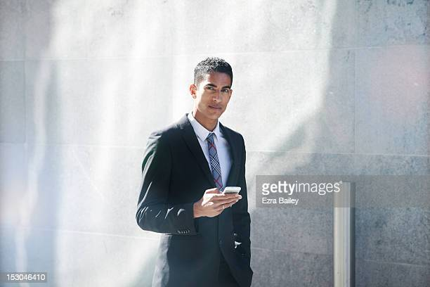 Portrait of a businessman with his phone.