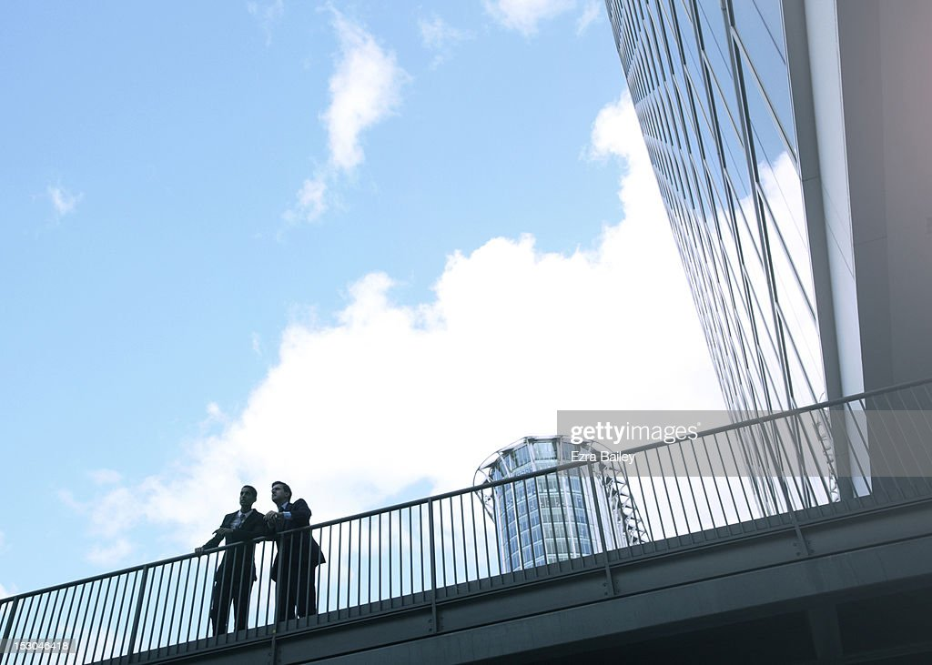 Two businessmen over looking the city. : Stock Photo