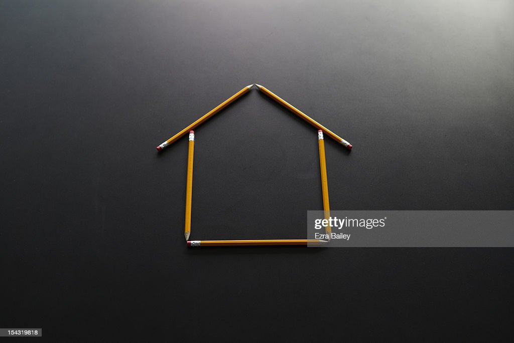 A house constructed by pencils on a desk. : Stock Photo