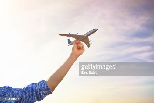 Man holding a model plane to the sky. : Stock Photo