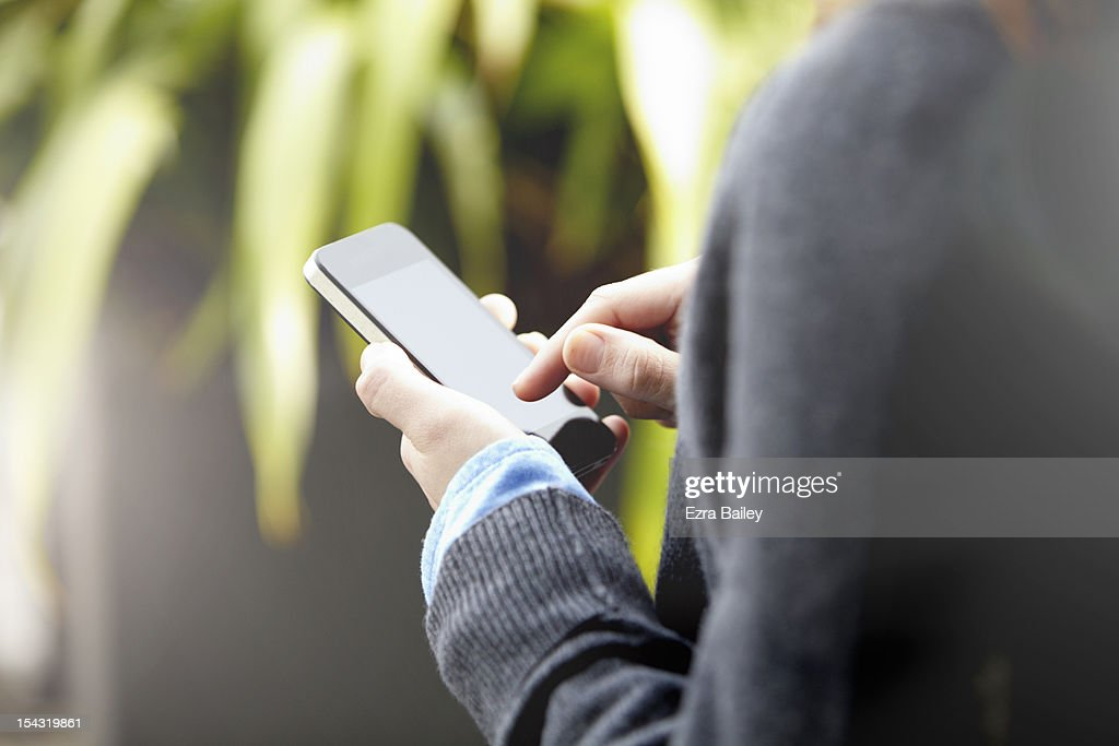 Close up of a woman using a mobile phone : Stock Photo