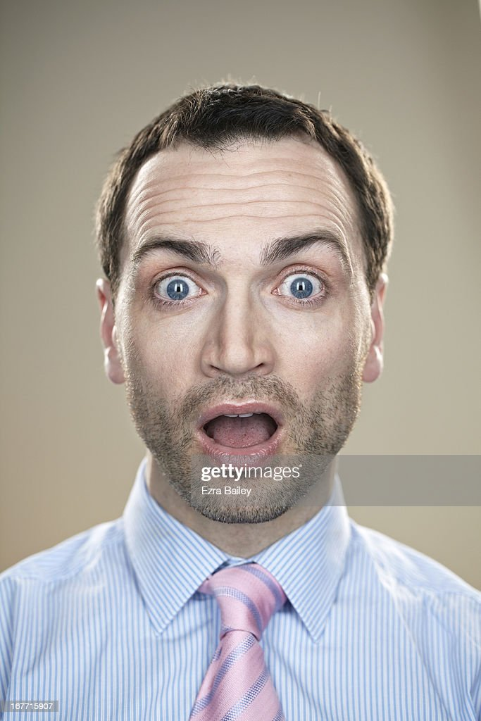 Male office worker looking surprised.
