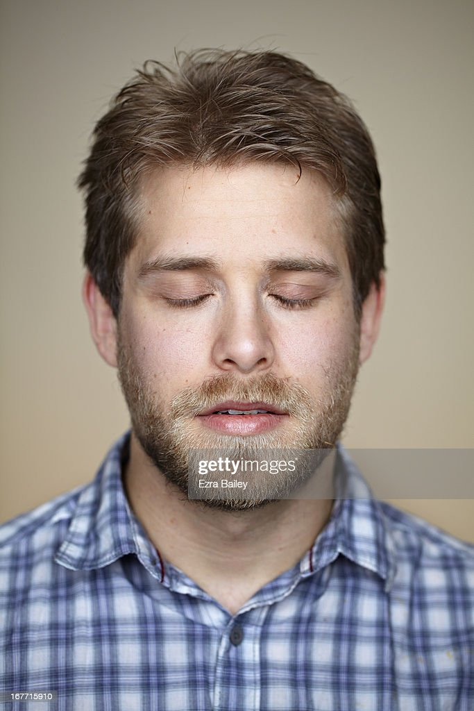 Portrait of a man with his eyes closed.